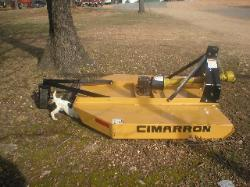 The dog is not for sale, but the hog is!  Get your Cimarron brush hog at Sundowner Tractor today!  918-696-5965